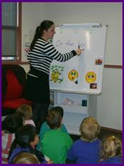 The teacher teaches kids writing