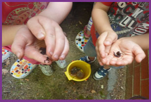 Kids hold worms