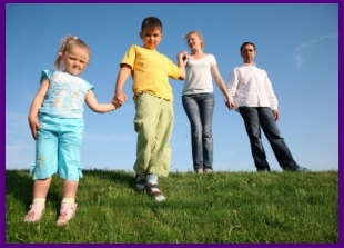 Image of whole family together stand up on the grass