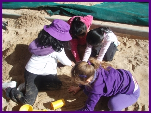Kids play in sandbox
