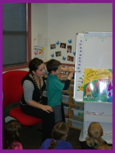 The teacher is teaching kids numeracy