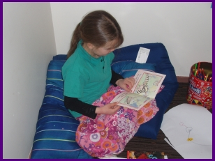 A girl reads a book